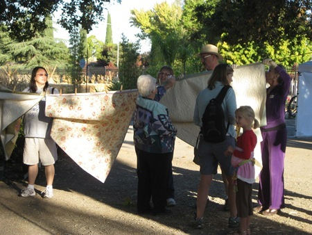 volunteers hanging the quilts